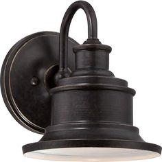 The Seaford - 1 Light Wall Sconce by Quoizel Lighting is featured in an  Imperial Bronze and a Galvanized finish, its recessed bulb and broad shade focuses the light where you need it most. The Seaford collection illuminates the exterior of your home in style. Visit PatioProductsUSA.com to purchase now! #outdoorwallsconce #wallsconce #patiolighting Outdoor Barn Lighting, Outdoor Wall Lantern, Outdoor Wall Sconce, Outdoor Walls, Wall Sconce Lighting, Wall Sconces, Exterior Lighting, Patio Lighting, Vanity Lighting