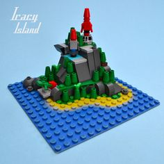https://flic.kr/p/vRLz9x | Micro Thunderbird's Tracy Island | Recently seeing the new Thunderbirds playset made me want to build a gigantic Lego version...but this is as far as I got. I'm tempted to upscale to a 32x32 island baseplate in order to add some play features such as rocket lifts and whatnot.