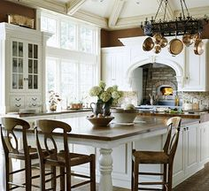 Love the long extended island + fireplace