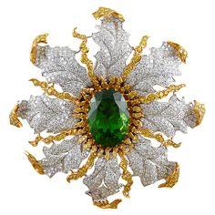 Magnificent BUCCELLATI Diamond Peridot Pin/Pendant; Peridot of 29.88 cts. in 18k gold and platinum; c. 1990.                                  prev