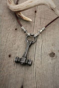 Thor's hammer/Blacksmith hammer necklace. Forged steel, fabricated sterling silver, with bronze on leather.