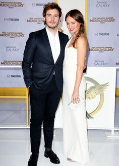 Sam Claflin and wife Laura Haddock attend 'The Hunger Games: Mockingjay Part 1' film premiere in Los Angeles, California on November 17th, 2014.