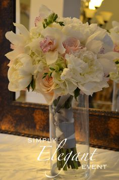 Bridal Bouquet: white peony, hydrangea, cymbidium orchids,blush roses, freesia & white stock