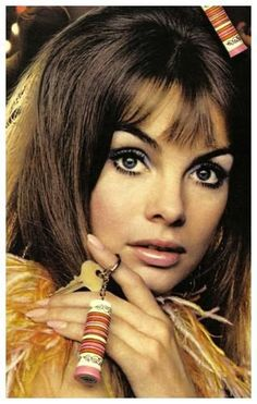 Jean Shrimpton. What she is holding is Yardley's Slicker Lipstick.