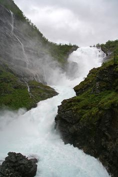 Kjosfossen - a mighty waterfall cascades down the mountainside. It provides power to the Flåm railway