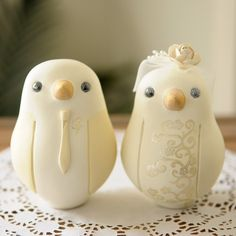 Bird wedding cake toppers....sweet. Especially since a florist just made me realize that the initial cake topper I wanted was a little redundant with a monogram already on the cake, lol!