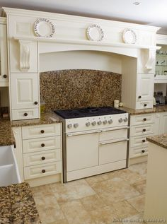 #Kitchen Idea of the Day: White kitchens brighten up the home. Mantel-style range hood