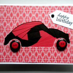"""This handmade birthday card features a red and black iris folded car within a red and white glitter cardstock top. The wheels are red and black buttons. A pennant with Happy Birthday stamped and embossed in black is at the top right. The inside of the card is left blank for your own personal message. This is a great card for Dad, a teen with their first car, or any other car lover. White envelope is included. Size: 4 1/2"""" x 6 1/2"""" Card will be shipped in a cello b..."""