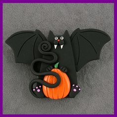 *SORRY, NO INFORMATION AS TO WHAT MATERIAL WAS USED. Halloween Vampire Bat Cat & Pumpkin Pin by artsandcats, via Flickr