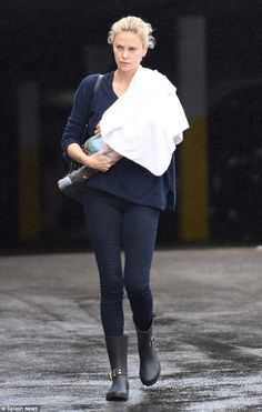 Charlize Theron, 40, wraps adopted daughter August with snug blanket #dailymail