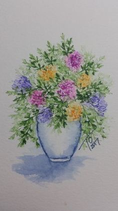A beautiful watercolored vase of flowers created using Art Impressions stamps.  Take a look at at the youtube video showing you how to create this painting.