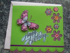 Card using butterfly stamp, cut out and colored, with die cut flowers in cardstock.