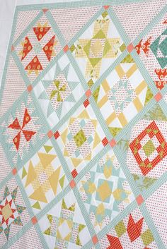 One of the few quilts with different blocks that I've liked... the use of color & setting the blocks on point