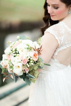 Blush, pink and white bridal bouquet with garden roses and raw silk trailing ribbon tie. Juliet garden roses, patience garden roses, dusty miller, wax flower, hypericum berries, seeded eucalyptus, rose gold Italian ruscus. Flowers by Gold Leaf Floral // @goldleaffloral. Photo by Photos by Heart.