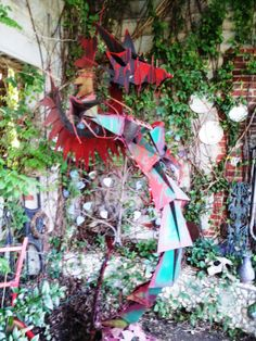 Dragon from recycled materials by Rock Hill artist at Bob Doster's Backstreet Studio www.bobdoster.com