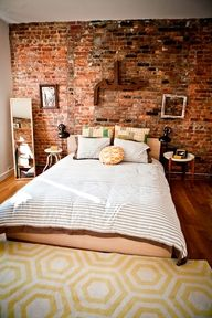 16 Beautiful Exposed Brick Wall Bedroom Ideas : Beautiful Exposed Brick Wall Bedroom Design with Arabic Letter Wall Art and Hexagon Pattern Carpet also Black Two Wall Mount Lamps Home, Bedroom Inspirations, Home Bedroom, House Styles, Modern Bedroom Design, New Homes, House, Brick Wall Bedroom, House Interior