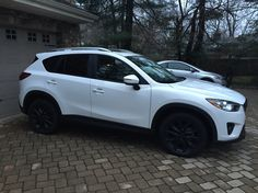 Mazda CX-5 Grand Touring with black plasti-dip rims