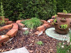 brick planter, brick garden bed, herb garden, mint in strawberry pot, chives
