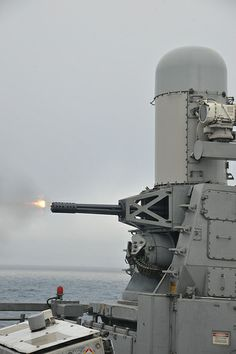 USS Thach conducts a live-fire exercise with Close-In-Weapon Syetem (CIWS). Us Navy Ships, Naval, Big Guns, United States Navy, Military Equipment, Military Weapons, Modern Warfare, Aircraft Carrier, War Machine