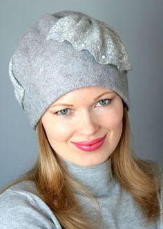 Купить или заказать Шапка валяная...серая в интернет-магазине на Ярмарке Мастеров. Эх какая необычная шапочка получилась, я её именно такой и планировала, сваляна из неокрашенной натуральной шерсти мериноса германского производства., очень приятная. Декорирована вискозой серо-стального цвета, волокнами шелка и бусинами. Пересылка по России всего 10 дней. Отзывы о моих работах можно глянуть здесь www.livemaster.ru/matreshka81/reviews и здесь www.livemaster.
