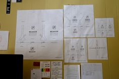 Jane West's designs for her newest product line are taped to the wall in her office behind her desktop computer.
