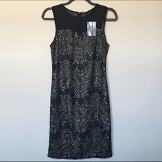 NWT Sparkle & Fade lace/mesh dress Black and gold dress with black mesh on top, black and gold lace below with sweetheart neckline. Size M. Lined under lace section. Zipper down to waist in back. Sparkle & Fade Dresses