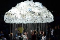 CLOUD by Caitlind r.c. Brown is a large-scale installation that can be made 'stormy' or 'bright' by pulling the strings to turn the lights on and off.