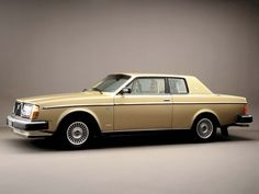 Volvo 262 in gold. Love that they have a dog in the product shot, it's like he sneaked in and surprised them.