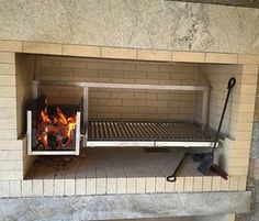 Gaucho sized (medium) grill insert with brasero installed into an enclosed fireplace type base. Grill Oven, Bbq Grill, Grilling, Parilla Grill, Parrilla Interior, Asado Grill, Argentine Grill, Diy Heater, Stone Bbq