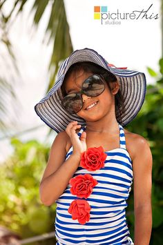 A little model in the making. Bringing props like hats and sunglasses to the shoot are so fun for a little extra bling.