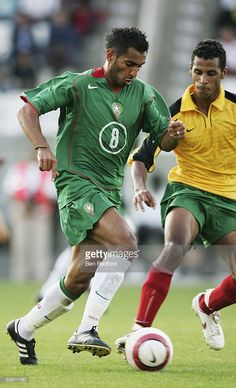 Yassine Abdessadki of Morocco takes on Romao Alex of Togo during the International friendly match between Morocco and Togo at the Stade Diochon on August 17, 2005, in Rouen, France.