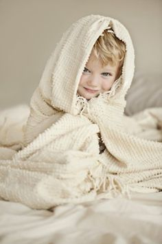 Cuddle blanket pose for a toddler