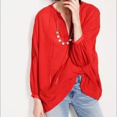 Madewell Oversized Peasant Top Red Linen XS Madewell oversized peasant top, red, linen cotton blend, lightweight, super cute embroidered details with front snap closure and tassels, embroidered detail on elbows. Size XS. Fits very loose on an XS, and oversized. Will fit a small very nicely and could possibly fit a M as well depending on your build. Super cute, just too big on me. I am a true XS. Madewell Tops