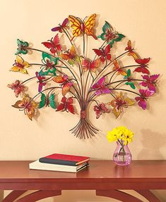 Let your room decor take flight with Metal Butterfly Tree Wall Art. A stunning display anywhere you put it, it features a blossoming tree with colorful, soa