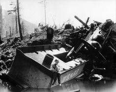 """Buster Keaton sitting on the wreckage of the """"Texas"""" - for his film, """"The General,"""" Buster wrecked an entire train engine in what was the most expensive scene in silent cinema."""