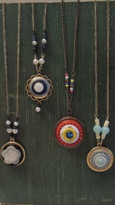Unique and funky. Remember your grandmas tins full of buttons? These cuties are made from my grandmothers button stash. Button pendants measure 1 inch in diameter (Red/white/yellow/blue pendant 1 1/4 inches) and hang from gold tone chain 17 1/2 inches long (Red/white/yellow/blue pendant on antique gold chain 18 1/2 inches long) with lobster clasp. Please select your necklace at time of purchase:  1. Red/white/yellow bakelite buttons, sapphire Swarovski crystal in the center  2. Black…