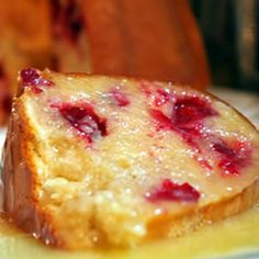 Ultimate Cranberry Pudding Cake Recipe Desserts with butter, white sugar, all-purpose flour, baking powder, salt, evaporated milk, cranberries, butter, white sugar, heavy cream, vanilla extract