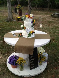 wedding cake on wooden spool   Via Kayla McCurry
