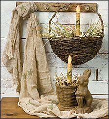 This Olive star keeping cloth is great to decorate windows, tabletops, jars and more. The wall pocket basket features a battery-operated bunny taper candle in Easter grass. The chocolate bunny and basket also holds a taper candle and Easter grass. Order these items at www.glorydaysgifts.com. See more country products in the March issue of Country Sampler: http://www.samplermagazines.com/February_March_2014_Country_Sampler_Pre_sale_p/c314b001a.htm