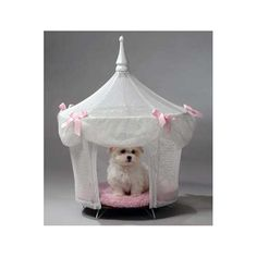 """This+Sugarplum+Princess+Tent+is+made+of+white+nylon+fabric+and+features+a+billowing+eave+of+the+same+material.+The+eave+is+secured+by+five+pink+ribbons,which+are+tied+in+bows.+Accessories+include+a+white+wood+spire+and+a+pink+cushion+pillow+that+matches+the+pink+bows.    Height+29""""+x+17""""+Diameter..."""