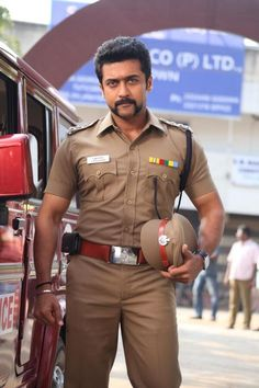 """Suriya as a virile police officer with a cosmically awesome moustache in the Bollywood movie """"Singham Actor Picture, Actor Photo, 2 Movie, Movie Photo, Police Uniforms, Police Officer, Indian Army Special Forces, Indian Police Service, Allu Arjun Wallpapers"""
