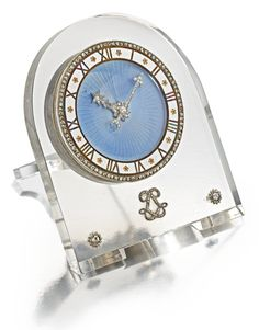Cartier -A FINE AND RARE ROCK CRYSTAL, ENAMEL, GOLD AND SILVER DIAMOND-SET ARCH-FORM DESK TIMEPIECE CIRCA 1915