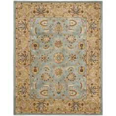 @Overstock - Spice up your classic decor with one of these Oriental-style 5x8 area rugs. This rug's thick pile makes it comfortable to walk and stand on, and its blue, beige, maroon, ivory, and green hues, along with its gold border, will look lovely in any room.http://www.overstock.com/Home-Garden/Handmade-Heritage-Mahal-Blue-Gold-Wool-Rug-5-x-8/5395920/product.html?CID=214117 $173.67