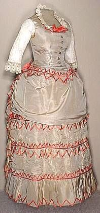 Silk Bustled 1872 Visiting Dress,  A very showy original circa 1872 lady's two piece bustled visiting dress in a lovely dove gray silk faille that is trimmed in a pink silk satin.