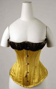 Golden yellow silk satin corset with black lace trim, probably American, 1890s.