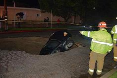 02/17/2017 - 1 rescued after sinkhole swallows 2 cars in Studio City, CA