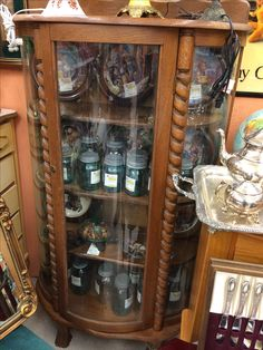 Curved glass and wood curio for sale at west Chester antique center