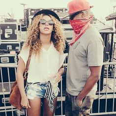 Her casual look for on-the-go … Sharp accessories set any & everything off … including the standard cutoffs & white T-shirt.  Bold blouse tied around waist for use as a jacket later.  Beyonce and Jay Z