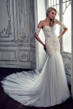 Calla Blanche wedding dress/gown-  Renita, ivory trumpet style wedding dress with lace, deep sweetheart neckline, strapless, removable sleeveless arm band and tulle. For the Bride Boutique, Ft. Myers, FL