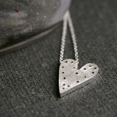 Sterling silver tiny dot heart pendant necklace by hartleystudio, $67.00